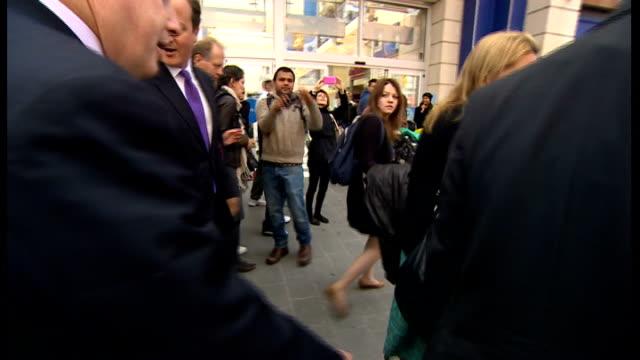 david cameron adn boris johnson campaign in harrow; further shots of david cameron and boris johnson along busy shopping street stopping for 'selfie'... - harrow stock videos & royalty-free footage