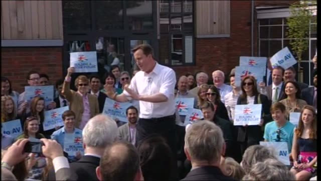 david cameron speech in bedford ext outdoor audience applaud david cameron as he makes way to podium david cameron speech sot its great to be back in... - ベルギー点の映像素材/bロール