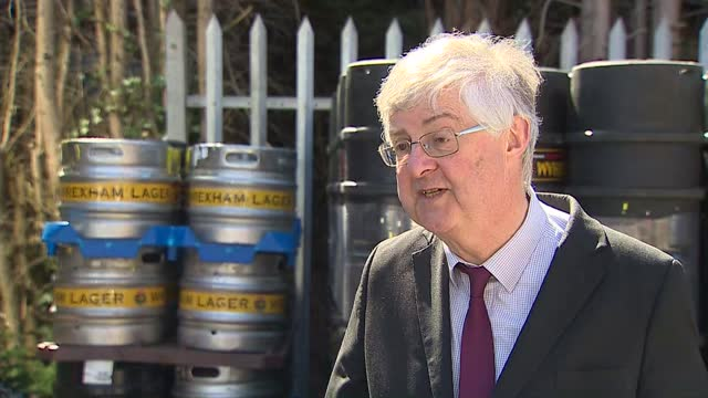 local elections: keir starmer campaiging in wrexham; wales: wrexham: ext gv mark drakeford am photocall as raising pint of beer with woman mark... - pursuit concept stock videos & royalty-free footage