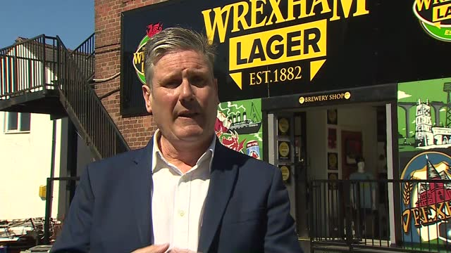 local elections: keir starmer campaiging in wrexham; wales: wrexham: ext sir keir starmer mp interview sot q: on commonwealth graves and whether uk... - identity politics stock videos & royalty-free footage