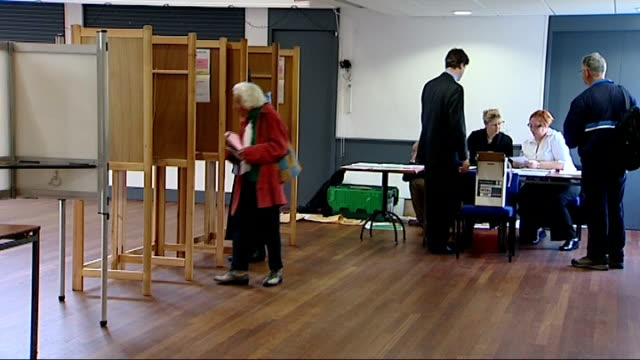 london mayoral election nick clegg at polling station england london putney ext nick clegg mp along and into polling station int nick clegg into... - ballot box stock videos & royalty-free footage
