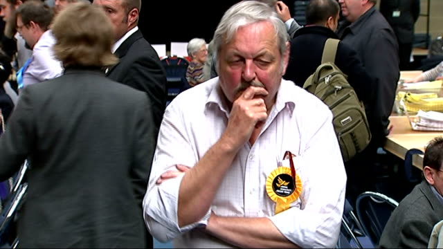 results london kingston int liberal democrat yellow rosette lib dem supporter looking unimpressed liberal democrat man along with hand to chin 'ukip'... - chin stock videos and b-roll footage