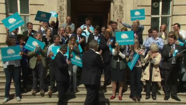 results roundup england london wandsworth ext theresa may mp along with brandon lewis mp and councillor ravi govindia and photocall on steps with... - itv london lunchtime news stock-videos und b-roll-filmmaterial