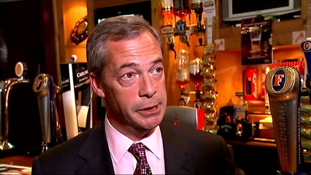 results ukip england essex benfleet photography** nigel farage mep photocall pulling pint of beer behind pub bar and standing holding up pint of beer... - blanket background stock videos & royalty-free footage
