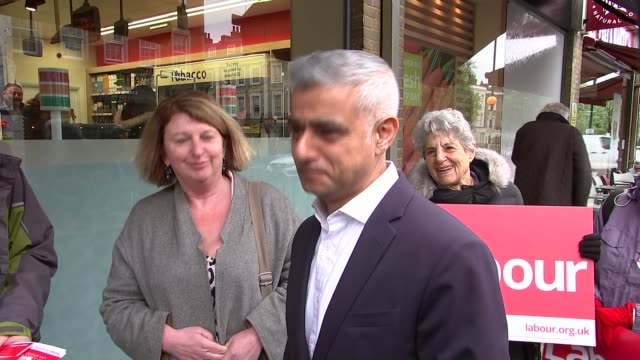 sadiq khan campaigning in westminster england london westminster ext 'westminster labour' stand / labour party activists chatting / sadiq khan along... - sadiq khan stock videos & royalty-free footage