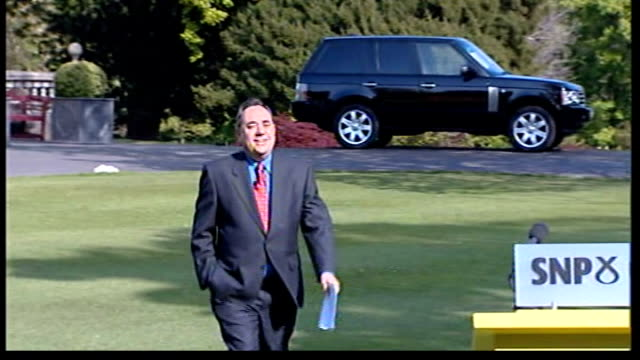 snp becomes biggest party in scottish parliament/ voting system chaos ext alex salmond across lawn to press conference podium alex salmond press... - alex salmond stock videos & royalty-free footage