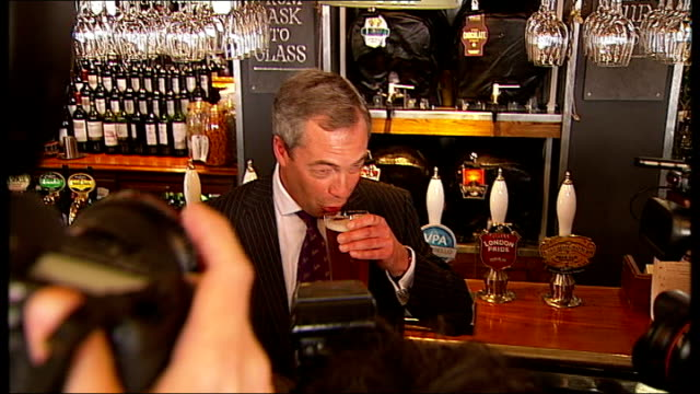 UKIP make big gains / Labour win South Shields byelection ****FLASH ENGLAND London INT Nigel Farage MEP standing behind bar in pub and drinking a...