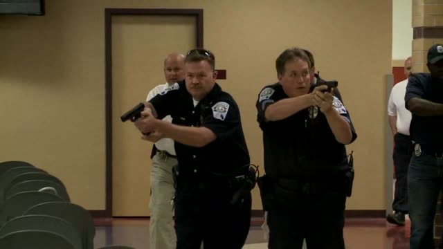 wxin local emergency responders practice a scenario with an active shooter at a local high school police participating in active shooter drill on... - drill stock videos & royalty-free footage