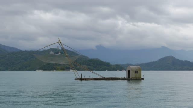 local fishing boat of sun moon lake, taiwan - sun moon lake stock videos and b-roll footage