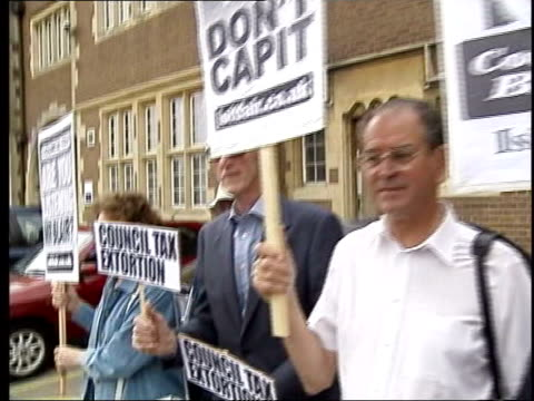Taxation Council Tax revaluation may be postponed TX Northamptonshire Towcester People protesting against rises in Council Tax TRACK CMS Retired...