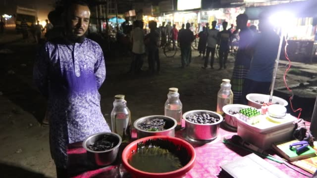 local hawker selling leech oil as sexual medicine - leech stock videos & royalty-free footage