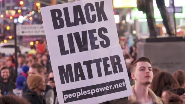 stockvideo's en b-roll-footage met local high school students joined forces with black lives matter activist to protest the death of stephon clark a 22 year old black man and father of... - black lives matter