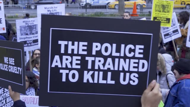 local high school students joined forces with black lives matter activist to protest the death of stephon clark a 22 year old black man and father of... - police brutality stock videos and b-roll footage