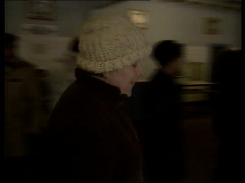 local houswife's life romania bucharest seq orelia petru along carrying loaves of bread as people stand in long queue outside shop in b/g ms orelia... - rumänien stock-videos und b-roll-filmmaterial