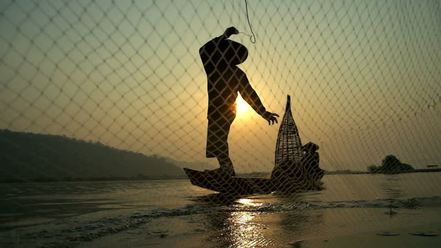 local lifestyles of fisherman working in the morning sunrise take with slow motion shot. - netting stock videos and b-roll footage