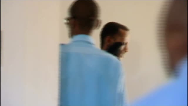 local man charged in connection with the murder of david tebbutt and kidnapp of judith tebbutt eastern kenya lamu ext ali babitu kololo arriving at... - legal defense stock videos and b-roll footage