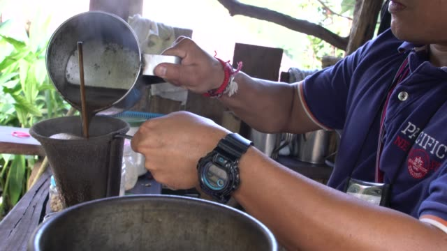 local man preparing coffee at a local cafe plantation in northern thailand - roasted coffee bean stock videos & royalty-free footage