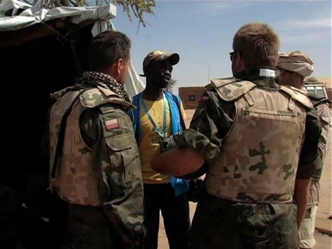 local man speaking to eufor soldiers in desert / chad / audio - western script stock videos & royalty-free footage