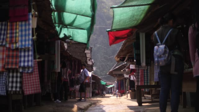 local market in front of mountain - souvenir stock videos and b-roll footage