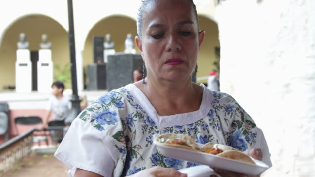 cu local mexican woman preparing street food for tourists and local people. - messico video stock e b–roll