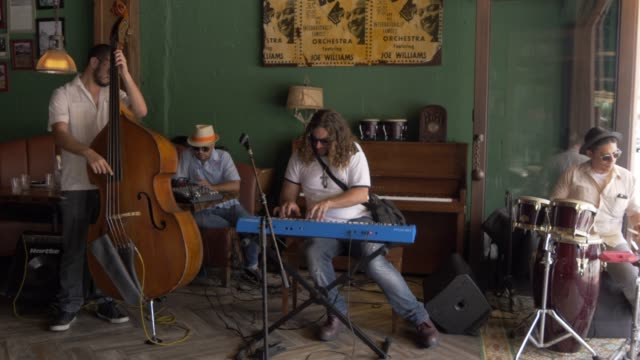 local musicians playing in cuban bar on 8th street in little havana, little havana, miami, florida, united states of america, north america - cuban culture stock videos & royalty-free footage
