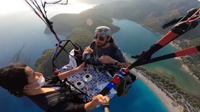 a local paragliding pilot in southwestern turkey has found a unique way to promote oludeniz beach and babadag mountain located in mugla province the... - pyjamas stock videos & royalty-free footage