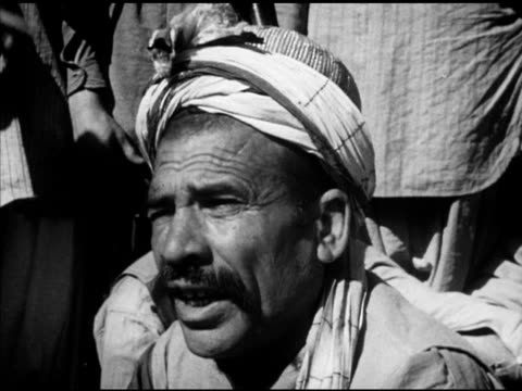 local pashtuns tribesmen standing sitting hillside men talking vs unidentified celebration dancers dancing in street to drums people watching dancers... - newsreel stock videos & royalty-free footage