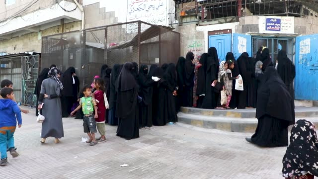 local people affected by the yemen conflict wait to receive bread as aid provided by a local charity center on april 04 2019 in sana'a yemen un... - the center stock videos & royalty-free footage