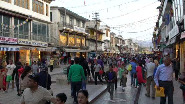 local people and tourist walk on the central very busy street in leh, ladakh in the evening - jammu e kashmir video stock e b–roll