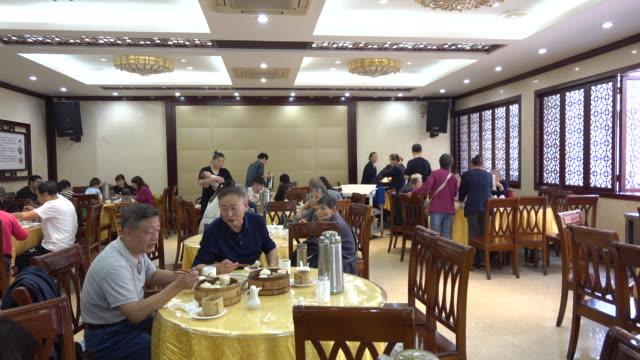 local people are enjoying breakfast in ancient yangzhou fuchun teahouse fuchun teahouse located in a traditional residential quarter still keeps the... - chinese tea cup stock videos and b-roll footage