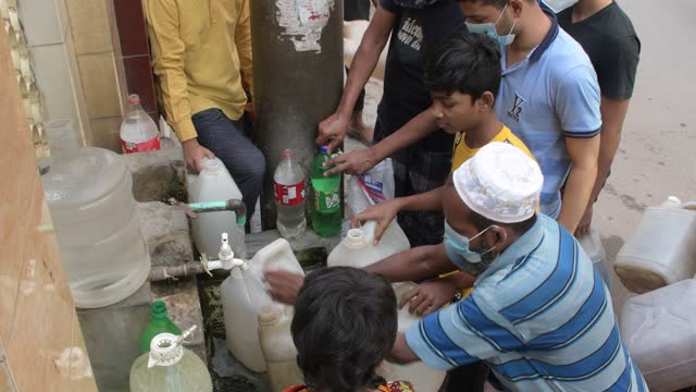 april 07: local people collect drinking water from a pump at lalbag in dhaka, bangladesh, on april 07, 2021. - water stock videos & royalty-free footage
