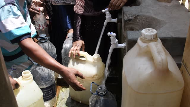 april 25: local people collect drinking water from a pump at lalbag on april 25 in old dhaka, bangladesh. - water stock videos & royalty-free footage