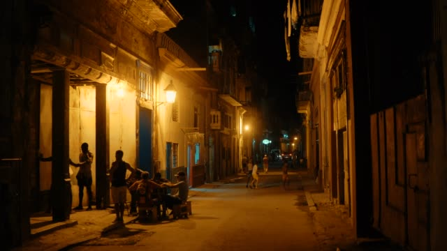 local people relaxing and socializing in the streets of havana old town at night - cuba stock videos & royalty-free footage