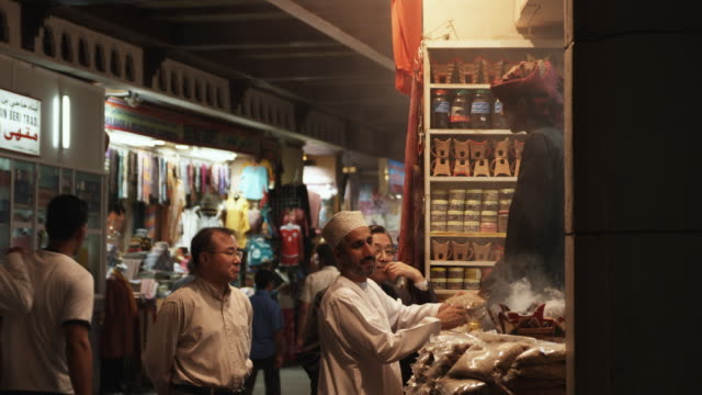 ms local person and tourist bargaining for frankincense in mutrah market, muscat, oman - oman stock videos & royalty-free footage