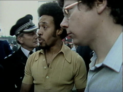local resident attempts to negotiate with senior police officer following intense rioting with youths in brixton; 2 april 1981 - 1981 stock videos & royalty-free footage