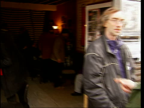 local residents fight hackney cafe eviction threat england london hackney ext protesters' sign above francesca's cafe tilt down campaigners outside... - petition stock-videos und b-roll-filmmaterial