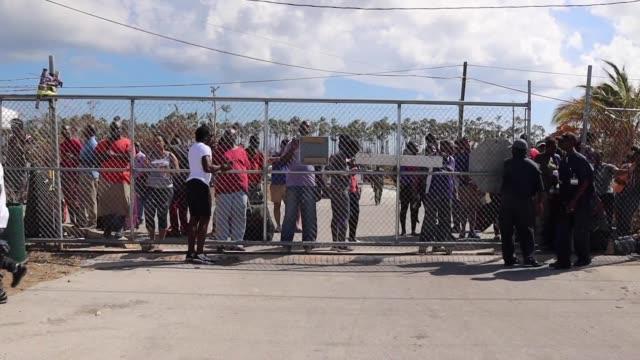 local residents trying to evacuate freeport via grand bahama international airport, in freeport, bahamas, on september 10, 2019. hurricane dorian... - evacuazione video stock e b–roll
