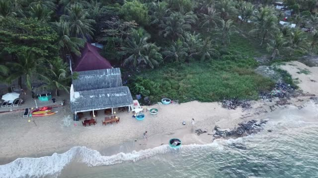 local restaurant on bai kem beach -phu quoc island vietnam - 4k drone video - vietnam meridionale video stock e b–roll