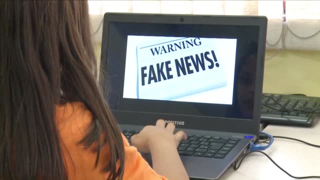 local school nestled in the outskirts of sao paulo is taking on the challenge of fake news training 11-15 year olds to surf the net with a critical... - fake stock videos & royalty-free footage