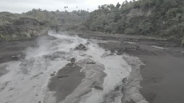 local st vincent resident kirk morris captured drone footage that shows ash-covered rooftops as well as volcanic material flowing along a riverbed on... - volcano stock videos & royalty-free footage