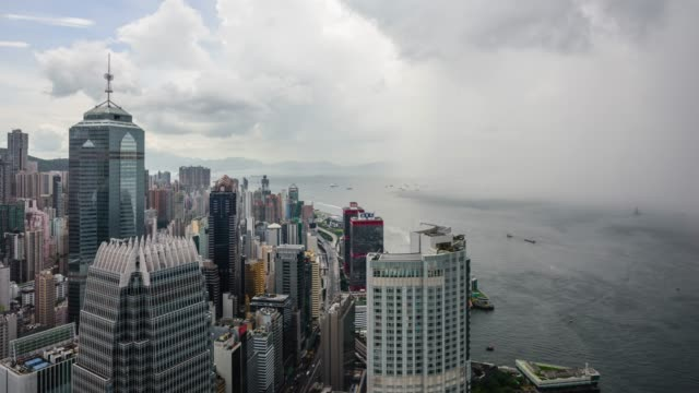 local sungwoo rainfall view of downtown with cloudscape in hong kong island, hong kong - hong kong stock-videos und b-roll-filmmaterial