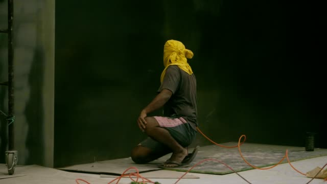 local thai technician man spraying black wall's details - pollution mask stock videos and b-roll footage