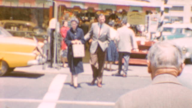 stockvideo's en b-roll-footage met local traffic / pedestrian couple / street vendors / obscured shot of wharf / fishermens grotto signage / fisherman's wharf in san francisco on june... - fisherman's wharf san francisco