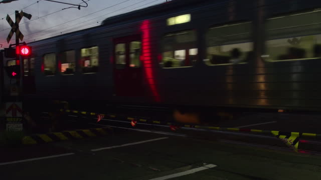 local train passing a street - level crossing stock videos & royalty-free footage