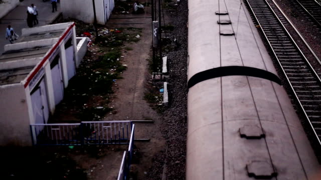 local train passing though station elevated view - moving past stock videos & royalty-free footage