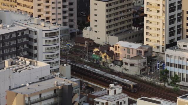 local trains passing through osaka - 列車点の映像素材/bロール