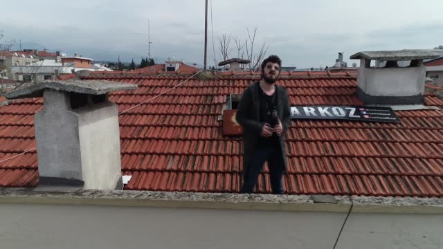local turkish music band treats their neighbours every week with a balcony and rooftop performance during the coronavirus lockdown in the izmir... - performing arts event stock videos & royalty-free footage