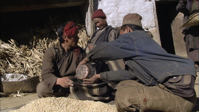 ws local villager measuring out grain for trading / hurikot village, low himalayas, dolpo, nepal    - measuring stock videos & royalty-free footage