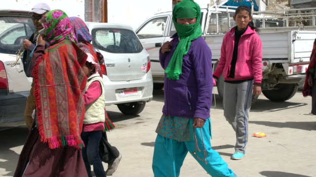 Local villagers going to the Korzok Tibetan Buddhist monastery to attend the morning service