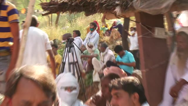 local villagers, including both men and women, gathered together in large number in rajasthan's kirauli on october 10, 2020. the people were sitting... - number of people stock videos & royalty-free footage